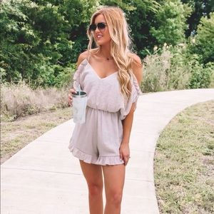 Shell colored romper perfect for any occasion!